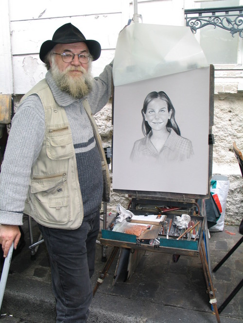 The bloke in Place Tertre who painted Kate, my neice, from a photo